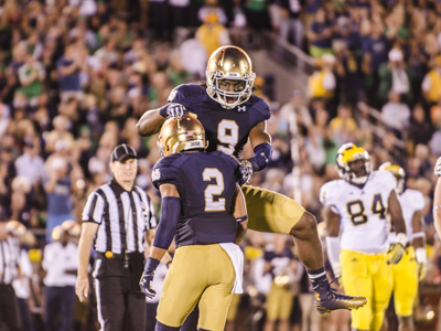 Sophomore LB Jaylon Smith celebrates with CB Cody Riggs