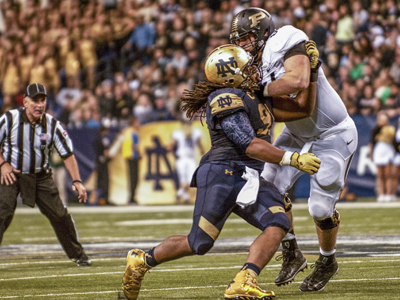 Junior DL Sheldon Day sheds a block